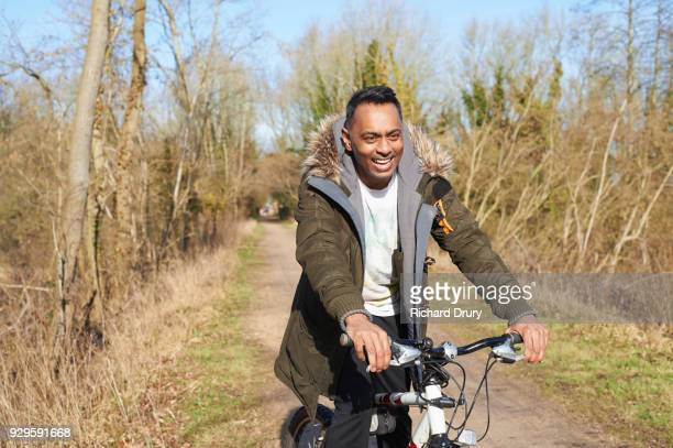Man cycling on cycle track