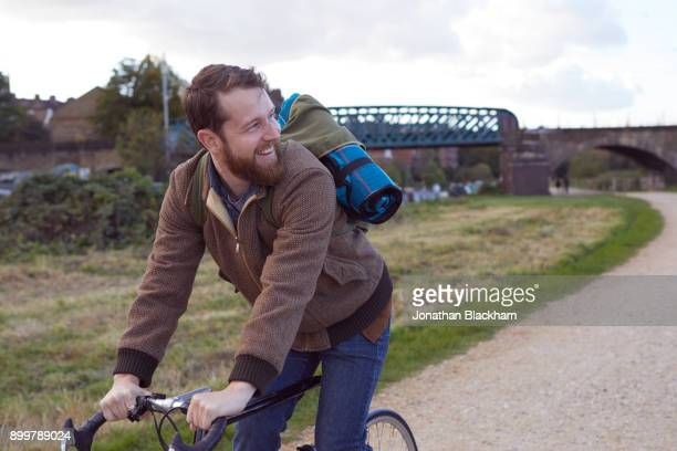 man cycling on path - mid adult stock pictures, royalty-free photos & images