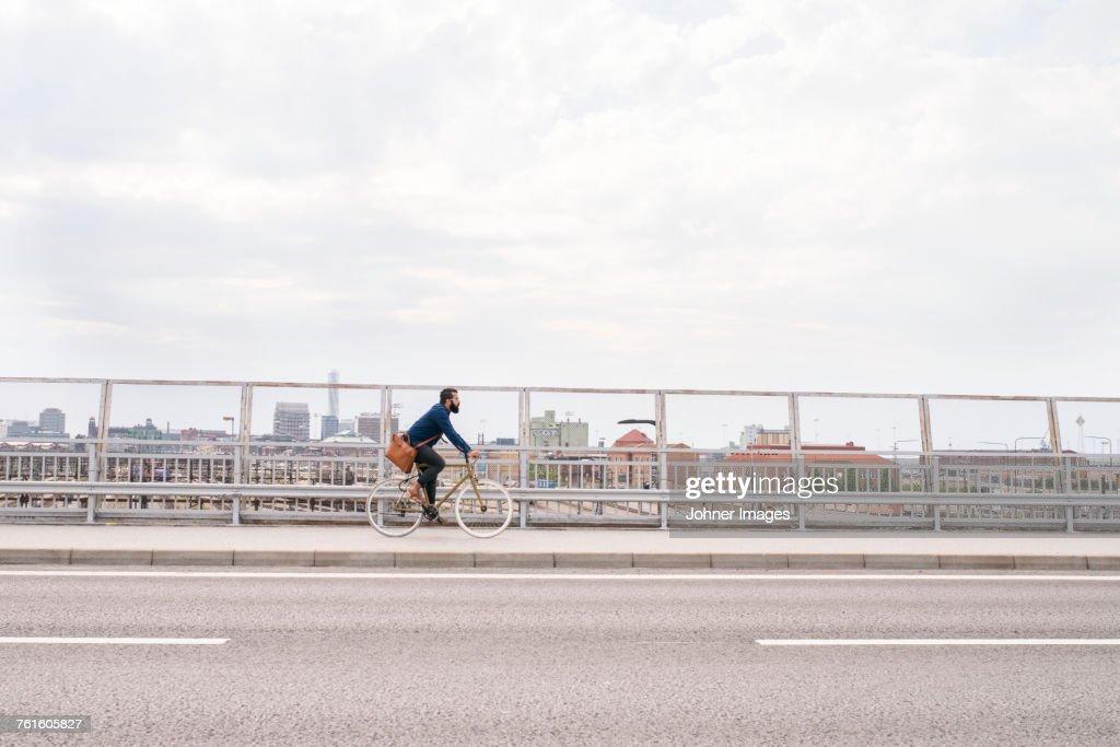 Man cycling on street : Stock Photo