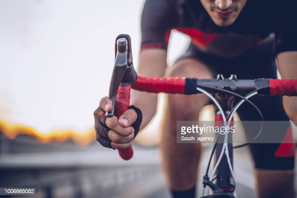 man cycling outdoors - endurance stock pictures, royalty-free photos & images