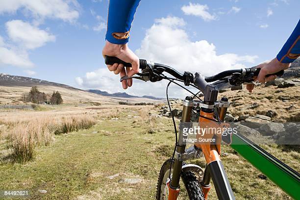 a man cycling - snowdonia stock photos and pictures