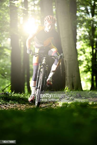 Man cycling through the forest