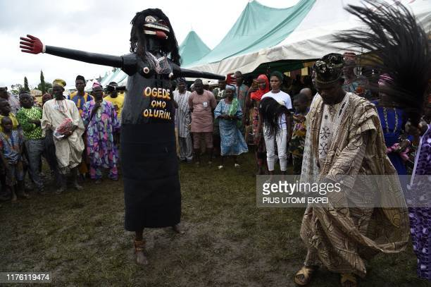 A man dance with a masquerade during the IgboOra World Twins festival to celebrate the uniqueness in multiple births at IgboOra Town in Oyo State...