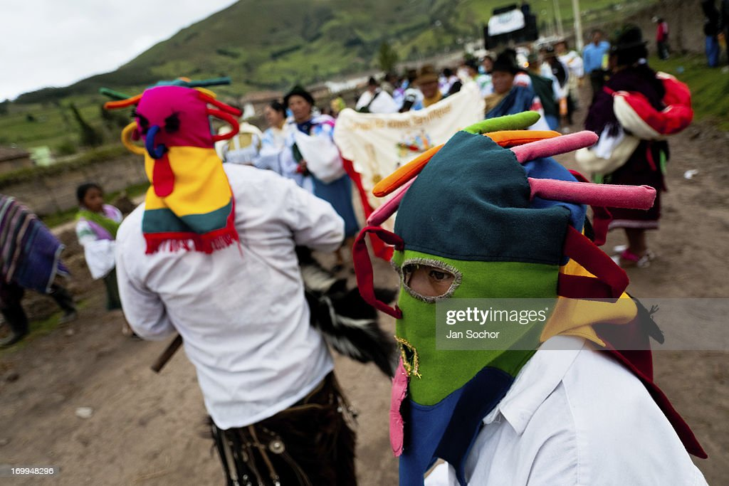 "A man dancer, wearing a colorful masque of Aya Uma - the creature from the Indian myths, leads the procession during the Inti Raymi fiesta on 26 June 2010 in the village of Pesillo, Ecuador. Inti Raymi, ""Festival of the Sun"" in Quechua language, is an ancient spiritual ceremony held in the Indian regions of the Andes, mainly in Ecuador and Peru. The lively celebration, set by the winter solstice, goes on for various days. The highland Indians, wearing beautiful costumes, dance, drink and sing with no rest. Colorful processions in honor of the God Inti (Sun) pass through the mountain villages giving thanks for the harvest and expressing their deep relation to the Mother Earth (Pachamama)."