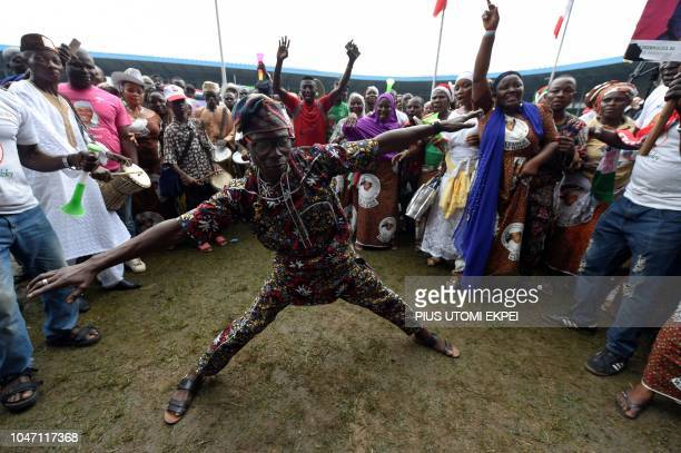 A man dances as supporters of former Nigerian vicePresident Atiku Abubakar celebrate his winning of the presidential ticket of the opposition...