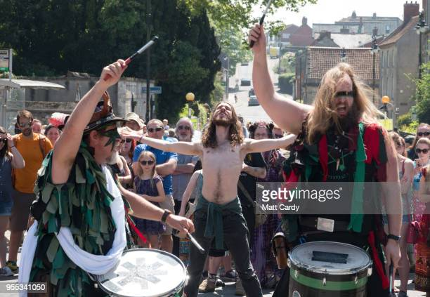 A man dances as the Pentacle Drummers perform as they wait for the Glastonbury Dragons to be paraded through the town as they take part in May Fayre...