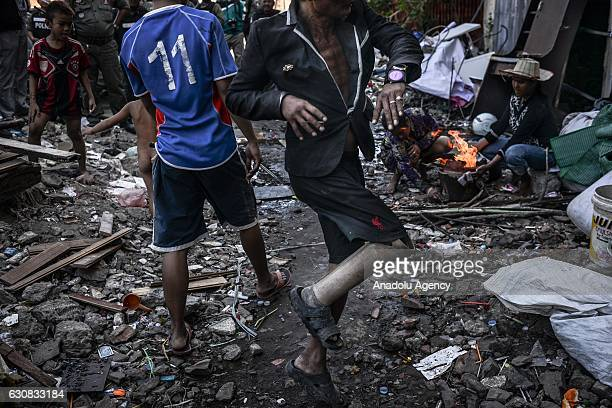 A man dances during a protest at the Borei Keila site in Phnom Penh Cambodia on January 3 2017 Families were evicted from Borei Keila community to...