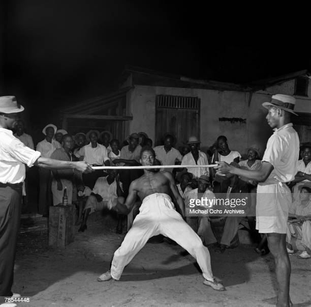 A man dances the Limbo in 1946 in Port Of Spain Trinidad