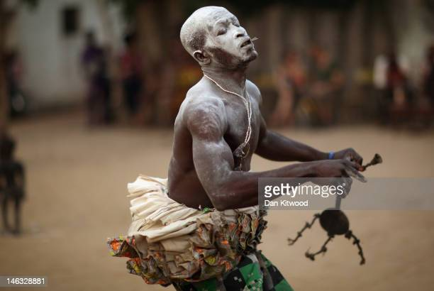A man dances while in a state of trance during a Voodoo ceremony on January 7 2012 in Ouidah Benin Ouidah is Benin's Voodoo heartland and thought to...