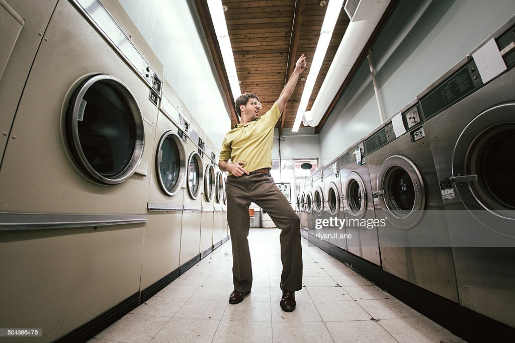 Man Dancing at Laundromat : Stock Photo