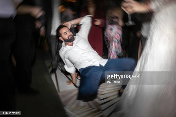 man dancing in the dance floor during party - ubriaco foto e immagini stock