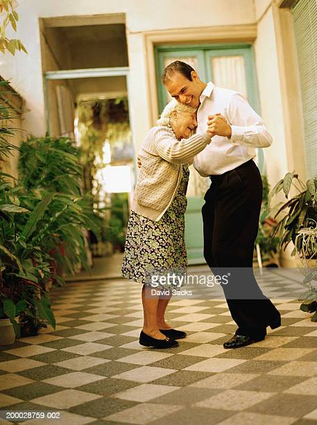 Man dancing with elderly woman