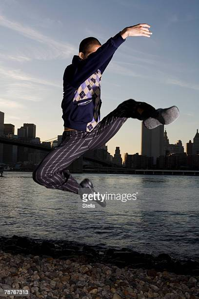 a man dancing with the manhattan skyline behind - male stripper stock pictures, royalty-free photos & images