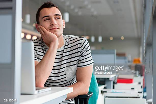 man daydreaming at desk - wasting time stock pictures, royalty-free photos & images