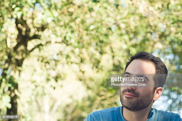 Man daydreaming outdoors