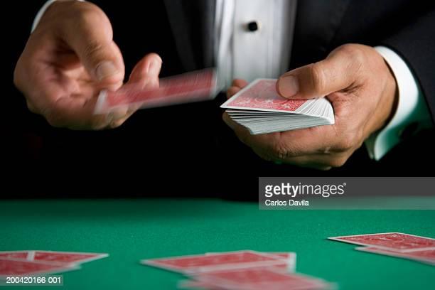Man dealing playing cards, close-up