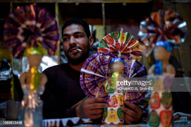 A man decorates traditional sugar candy at a market in the capital Cairo on November 19 ahead of celebrations of the birthday of Prophet Mohammed...
