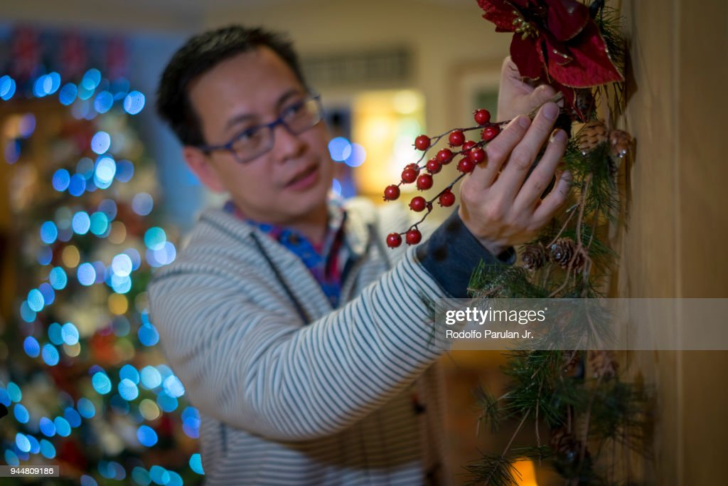Man decorating for christmas : Stock Photo