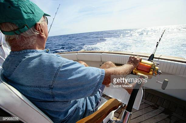 man deep sea fishing - big game fishing stock photos and pictures