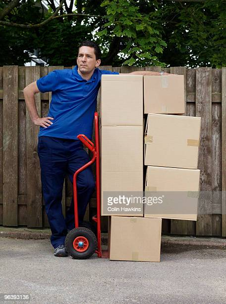 man delivering boxes on trolley