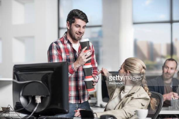 Man delivering coffee to office workers