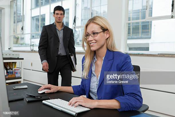 Man delivering file to boss