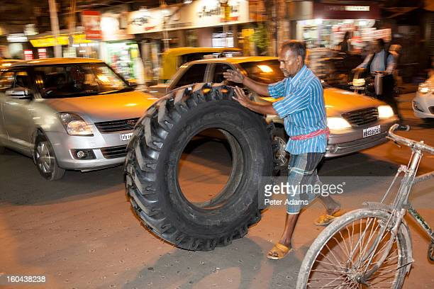 Man Delivering Tyre Kolkata Street, India