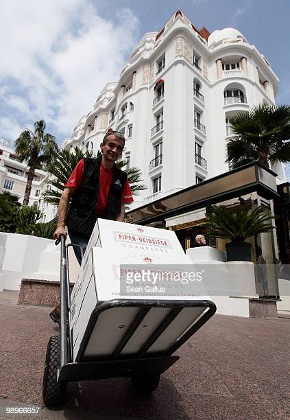 A man delivers boxes of champagne along the Croisette prior to the annual film festival on May 11 2010 in Cannes France The 63rd Cannes Film Festival...