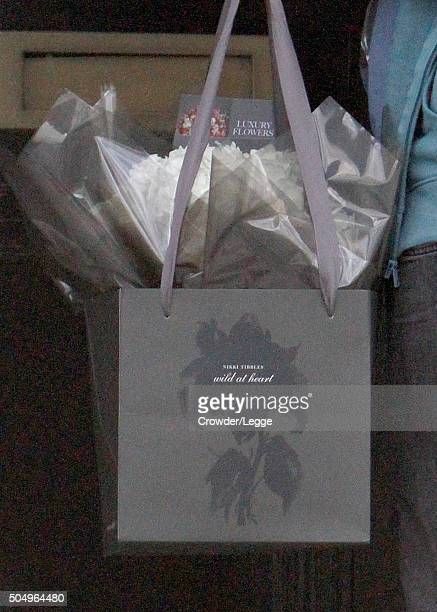 A man delivers flowers at the home of Alan and Rima Rickman on January 14 2016 in London England