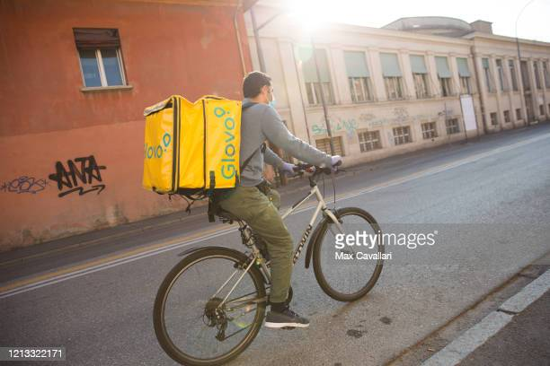 A man delivers food on his bike on March 18 2020 in Bologna Italy The Italian government continues to enforce the nationwide lockdown measures to...