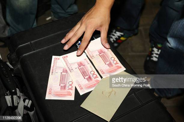 """Man delivers """"Lai See"""" to media during the wedding of Kenneth Fok Kai-kong and former China diving queen Guo Jingjing at Nansha Hotel, Panyu,..."""