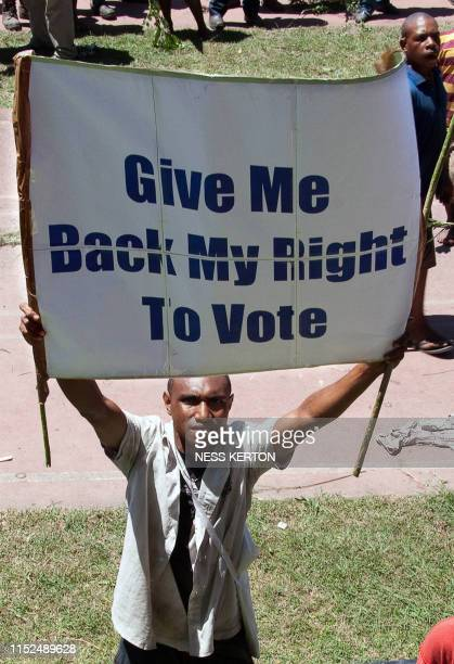 A man demands suffrage as thousands of Papua New Guineans protest against the government's plan to delay national elections during a rally in Port...