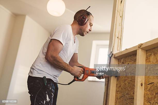 Man demolishing and rebuilding walls