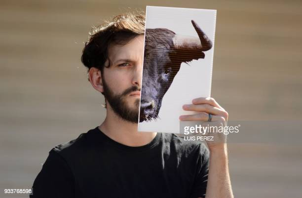 TOPSHOT A man demonstrates against bullfighting during a protest called by the NGO AnimaNaturalis as part of their campaign against animal abuse...