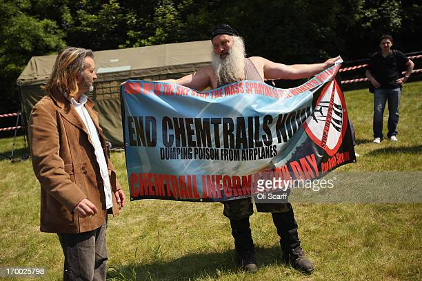 A man demonstrates against 'Chemtrails' in a protester encampment outside The Grove hotel which is hosting the annual Bilderberg conference on June 6...