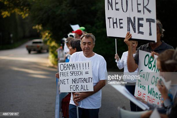 A man demonstrates for net neutrality in the exclusive neighborhood of BelAir outside a USC Shoah Foundation fundraiser to be attended by President...