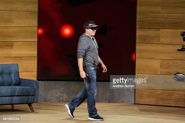 A man demonstrates using the new virtual reality gaming head set titled the Microsoft HoloLens at a media event for new Microsoft products on October...