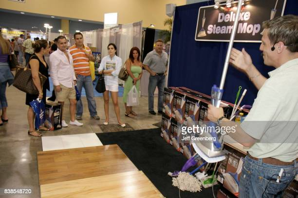 A man demonstrating a household product at the Home Design and Remodeling Show at Miami Beach Convention Center