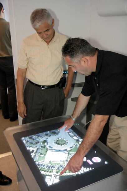a man demonstrating a smartechs tabletop touch computing at the