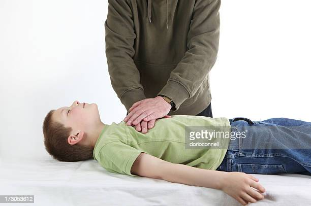 Man demonstrating CPR on a young boy