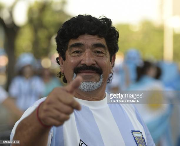 A man depicting former fooball star Diego Maradona of Argentina poses for a photo outside the Maracana stadium in Rio de Janeiro Brazil on June 15...