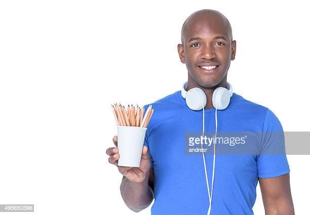 Man designer with color pencils