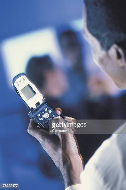 Man dialing cell phone