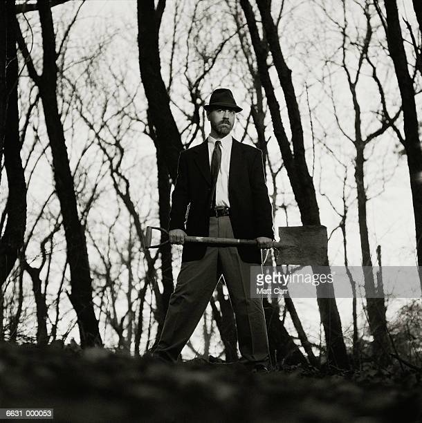 Man Digging Grave in Forest