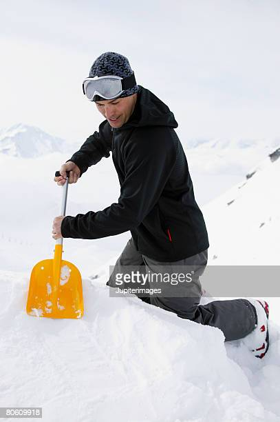 man digging in snow - only young men stock pictures, royalty-free photos & images