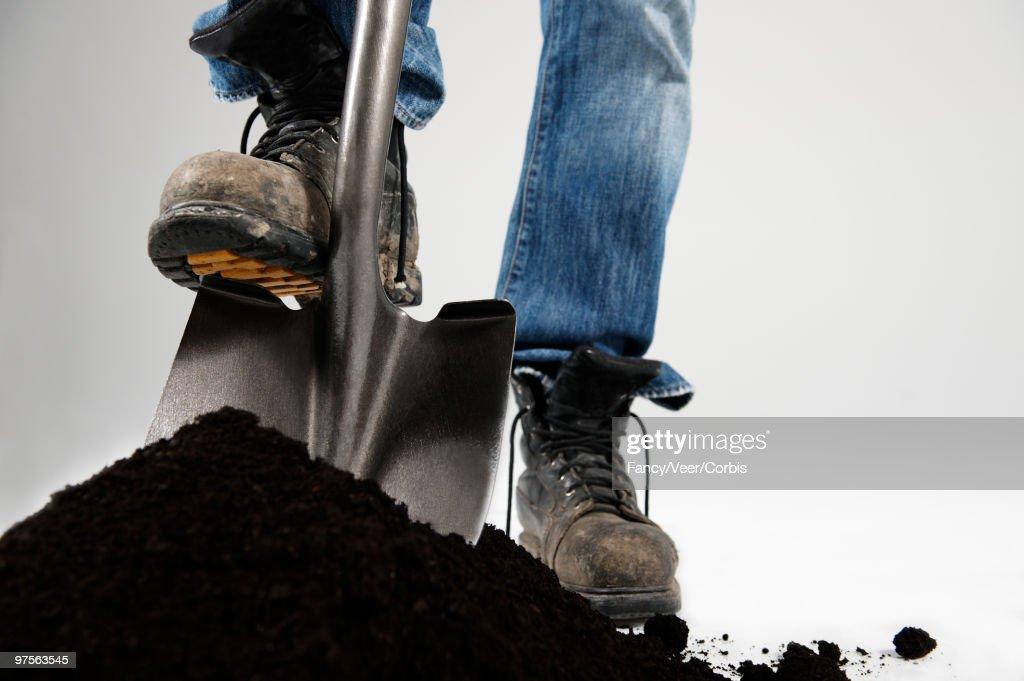 Man digging with shovel : Stock Photo