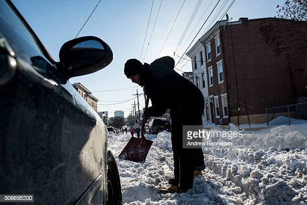 Man digs out a car following a blizzard on January 25, 2016 in Wilmington, Delaware. Many streets in the city remained covered with snow. A major...