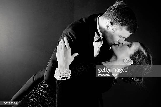 man dipping woman and kissing her - evening wear stock pictures, royalty-free photos & images