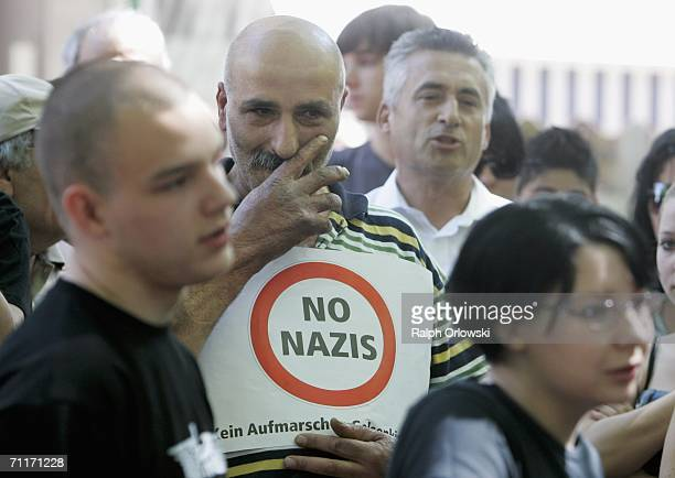 Man dipslays a sign as he protests a Neo-Nazis demonstration June 10, 2006 in Gelsenkirchen, Germany. About 200 right-wing National Democratic Party...