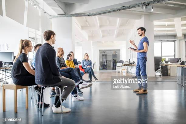 man discussing new ideas with team - participant stock pictures, royalty-free photos & images